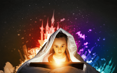 Young girl hiding under blanket with story book and light. Castles, bats made of colourful light behind her
