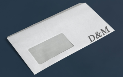 Image of an envelope with a window with logo printed on the bottom corner