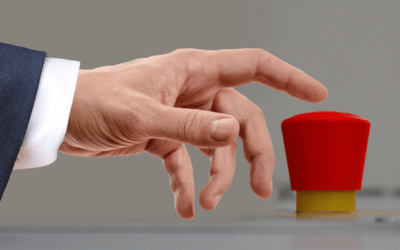 Business mans hand pressing large red foam button