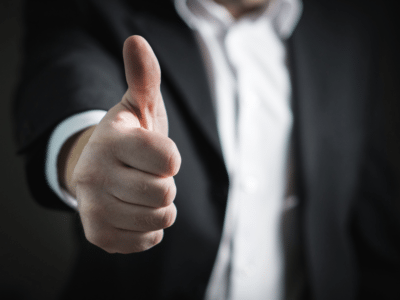 Image of a business man giving a thumbs up